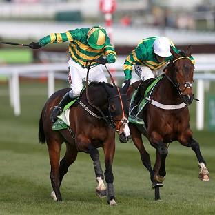 Jezki, ridden by Barry Geraghty, left, edged out My Tent Or Yours at Cheltenham