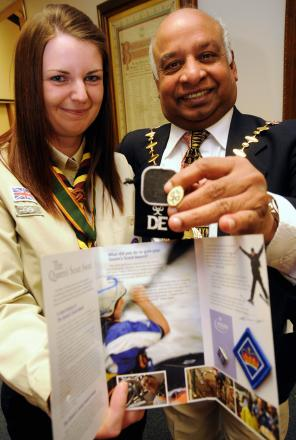 Hayley Bench receives the DoE Gold Award and Queen's Scout Award from the mayor.