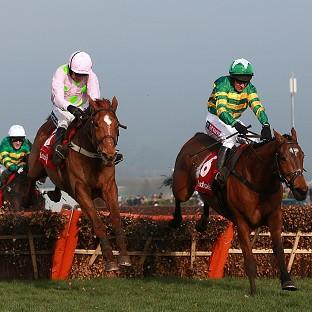 More Of That, right, holds off Annie Power to win the Ladbrokes World Hurdle