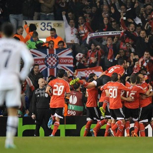 Andover Advertiser: Benfica players celebrate after Luisao scores their second goal at White Hart Lane