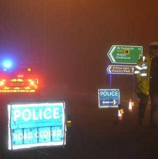 Andover Advertiser: Police man a road block in Gillingham, near Beccles, Norfolk, as emergency services are attending a helicopter crash in Norfolk, police said.