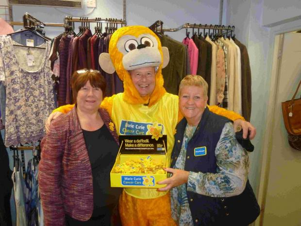 Bill is pictured here with the shop's assistant manager Carol De Mailo and manager Jill Tizzard.