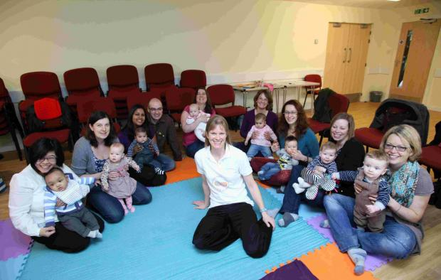 Liz Morland, centre, with parents and children at her signing class for babies and parents at Woodley Village Hall