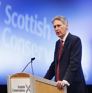 Andover Advertiser: Secretary of State for Defence Philip Hammond addresses the 2014 Scottish Conservative party conference in Edinburgh
