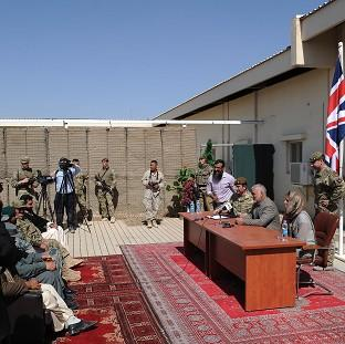Andover Advertiser: Brigadier James Woodham and the Provincial Governor of Lashkar Gah holding a press conference to signify the handover of Main Operating Base Lashkar Gah from British military control to Afghan security forces.