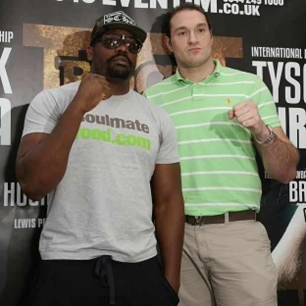 Andover Advertiser: Dereck Chisora, left, and Tyson Fury, right, will fight one another in July