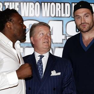Tyson Fury, right, will prepare to face Dereck Chisora with a fight behind closed doors