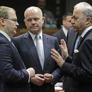 Andover Advertiser: Foreign Secretary William Hague, centre, French foreign minister Laurent Fabius, right, and Estonia's foreign minister Urmas Paet during the EU foreign ministers council in Brussels (AP)