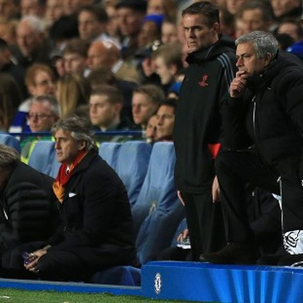 Andover Advertiser: Chelsea manager Jose Mourinho, right, was delighted to see his side go through