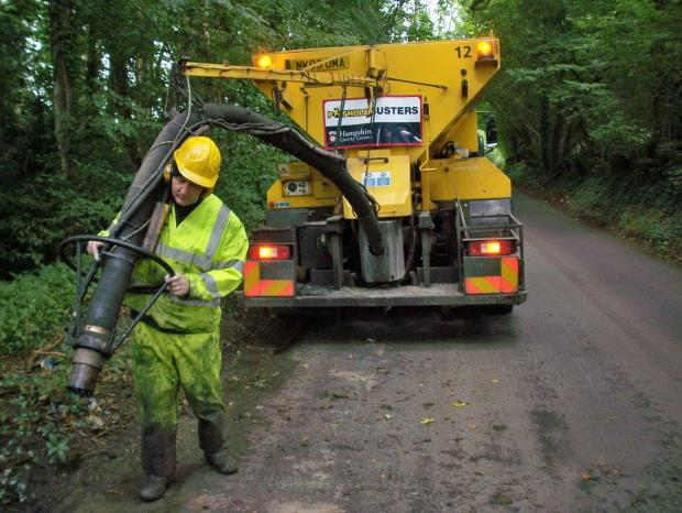 Hampshire County Council's 'Pothole Busters' get to work with a jetpatcher machine