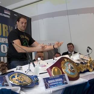 Tyson Fury tosses the top table aside before walking out of the preview press conference for July's fight with Dereck Chisora (AP)