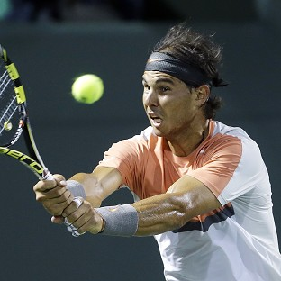 Rafael Nadal, pictured, made short work of Lleyton Hewitt (AP)