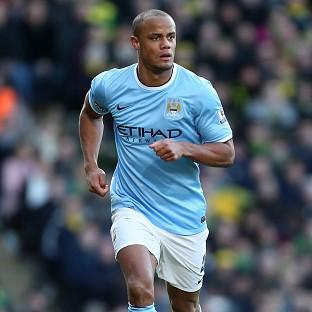 Andover Advertiser: Vincent Kompany is back from suspension for Manchester City's trip to Old Trafford on Tuesday night