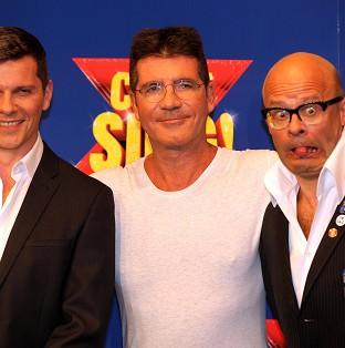 Andover Advertiser: Nigel Harman (left) will play Simon Cowell (centre) in the musical penned by Harry Hill (right).