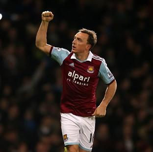 Mark Noble celebrates scoring the opening goal of the game