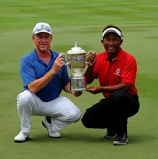 Miguel Angel Jimenez, left, and Thongchai Jaidee, right, share the EurAsia Cup (AP)