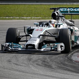 Lewis Hamilton won the Malaysian Grand Prix by finishing just over 17 seconds ahead of Nico Rosberg (AP)