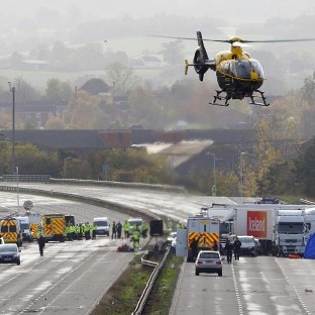 Andover Advertiser: Emergency services work at the scene on the M5 motorway close to Taunton following the pile-up