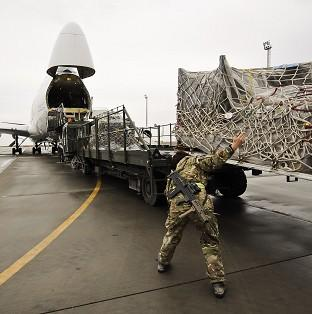 Equipment being loaded into a Boeing 747 headed f