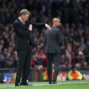 Manchester United manager David Moyes, left, has vowed that his side will go for victory in Munich