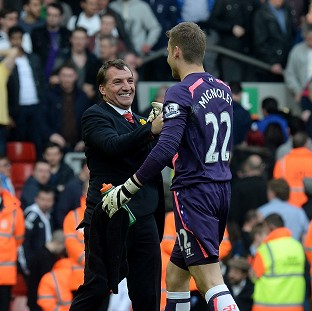 Liverpool goalkeeper Simon Mignolet, right, has hailed the team spirit created by manager Brendan Rodgers, left