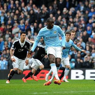 Yaya Toure scores from the penalty spot against Southampton