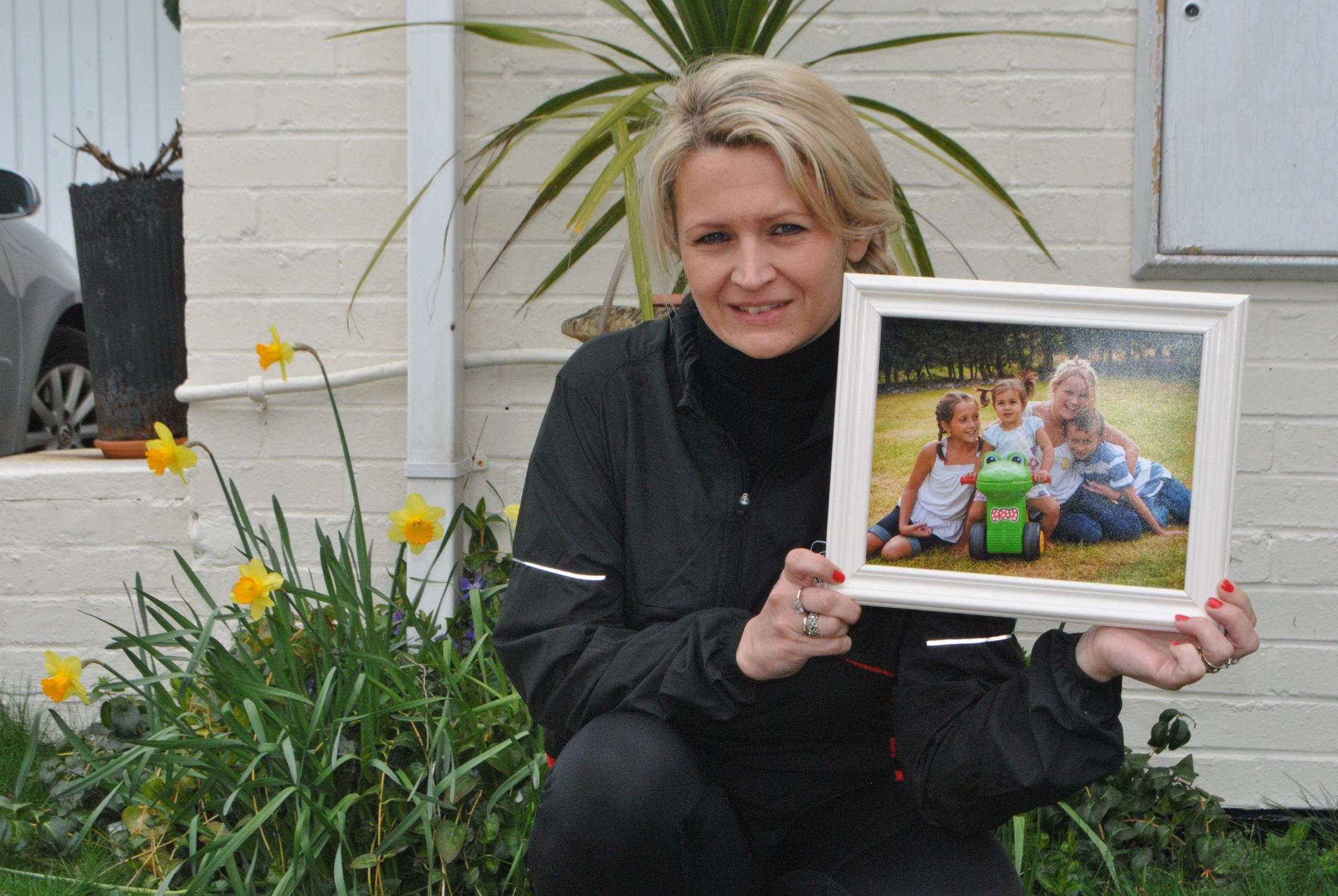 Emma Carter-Dasai with a picture of her children.