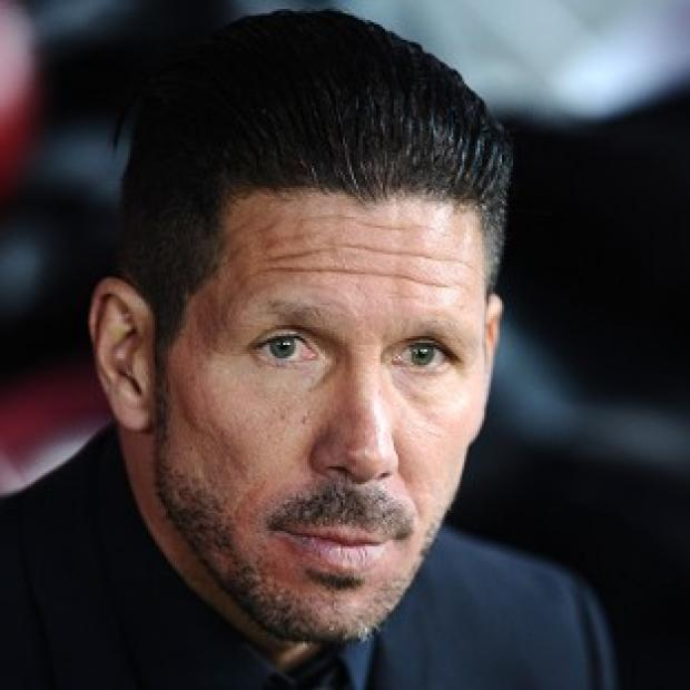 Andover Advertiser: Atletico Madrid coach Diego Simeone is keeping his feet on the ground