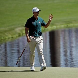 Adam Scott made a solid start to his Masters defence (AP)