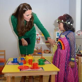 Andover Advertiser: The Duchess of Cambridge meets Bailey Taylor, six, during her visit to the Rainbow Place Children's Hospice in Hamilton, New Zealand