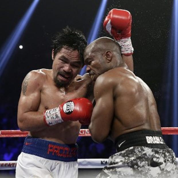 Andover Advertiser: Manny Pacquiao, left, avenged his defeat by Timothy Bradley (AP)