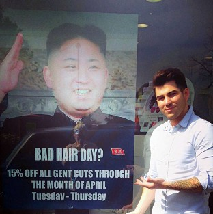 Barber challenged over Kim poster