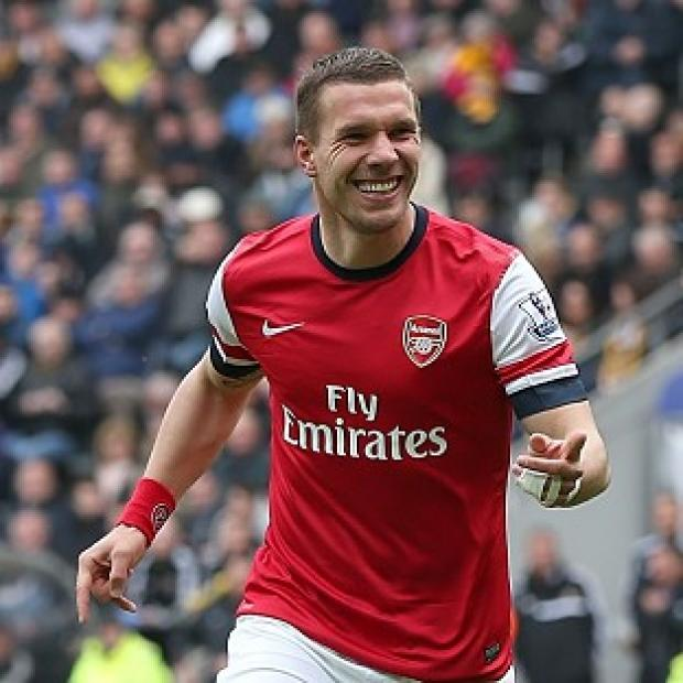 Andover Advertiser: Arsenal's Lukas Podolski netted twice in his side's win