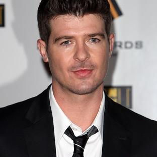 Andover Advertiser: Robin Thicke's song Blurred Lines has been named the UK's most downloaded track of all time