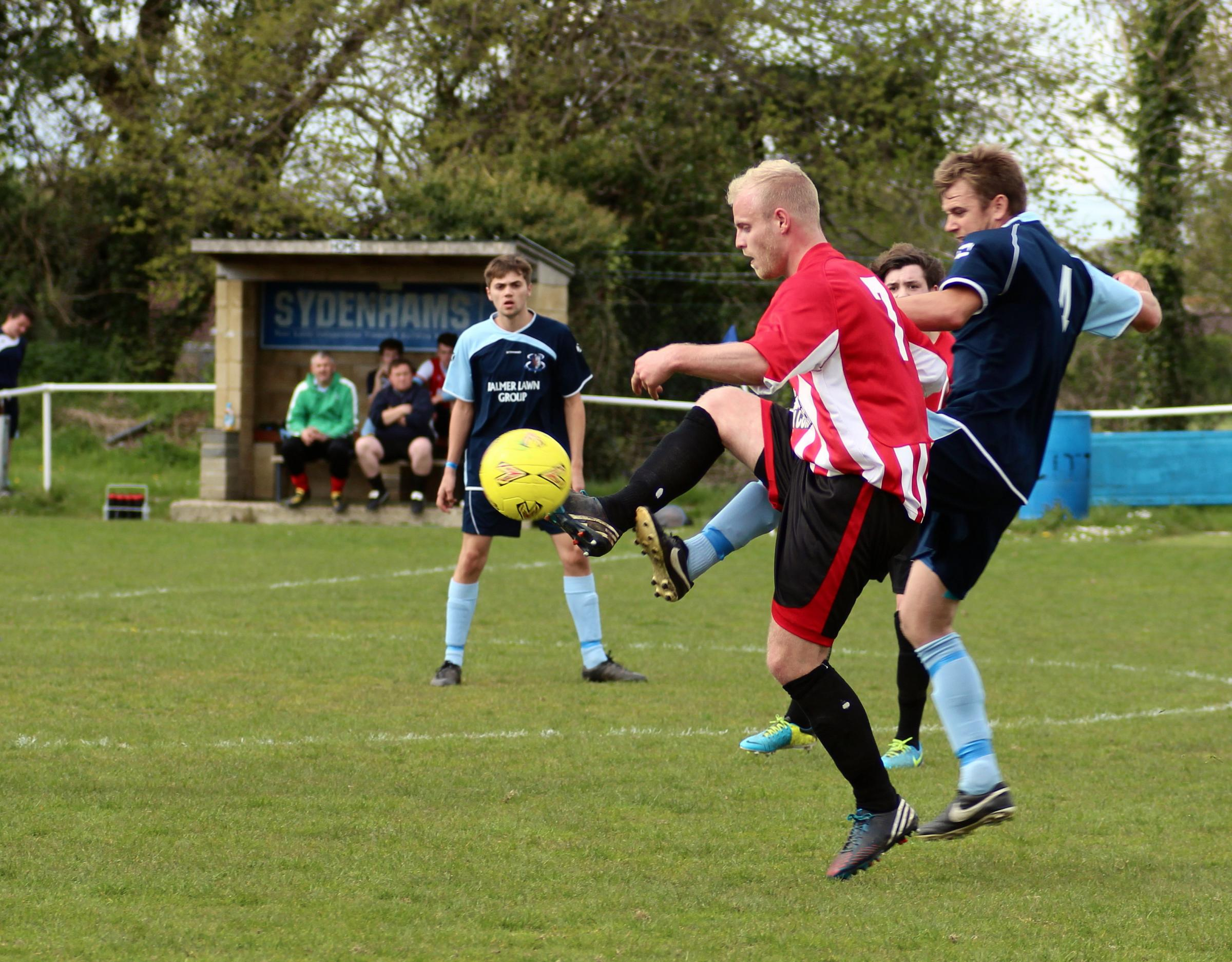 Tom Mudy (red and white) in action at Fawley on Saturday