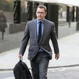Former News of the World editor Andy Coulson arrives at the O