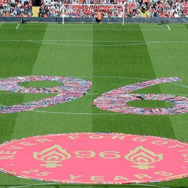 Andover Advertiser: Fans' scarves make up a 96, filling the centre circle before the Hillsborough 25th Anniversary Memorial Service at Anfield Stadium, Liverpool