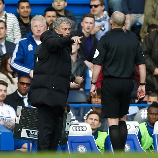 Jose Mourinho, centre, was unhappy with referee Mike Dean, right, during Chelsea's defeat to Sunderland