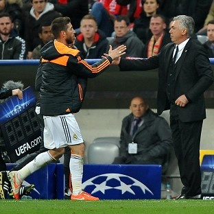 Carlo Ancelotti, right, shakes hands with Sergio Ramos, who scored twice in Real's emphatic victory