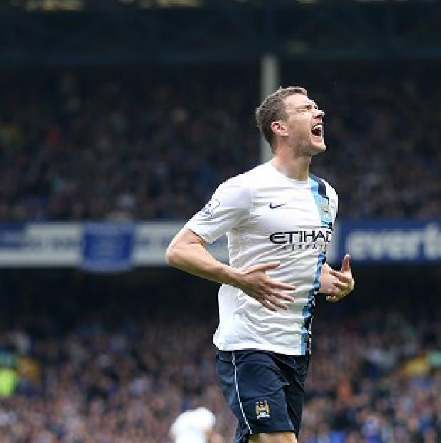 Andover Advertiser: Edin Dzeko's brace helped Manchester City claim victory at Goodison Park