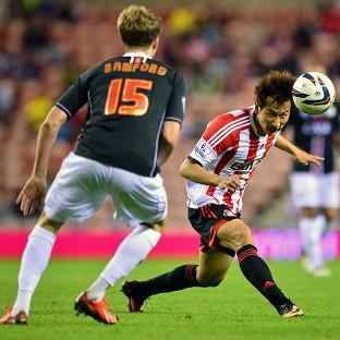Sunderland are unlikely to face further action for fielding Ji Dong-won, right, with incomplete registrat