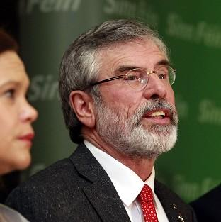 Andover Advertiser: Gerry Adams speaks to the media in Belfast after his release following five days of police questioning (AP)