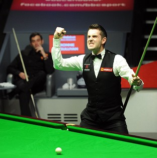 Mark Selby celebrates winning his first World Championship title