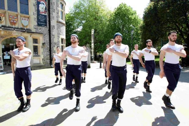 The full cast of HMS Pinafore took to the streets of Winchester.
