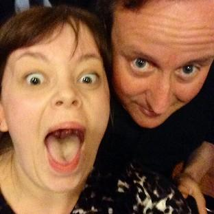 Prime Minister David Cameron poses for a selfie with Becky Smith in