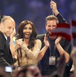 Andover Advertiser: Austria's Conchita Wurst, who performed the song Rise Like a Phoenix, listens as points are announced at the final of the Eurovision Song Contest in Denmark (AP)