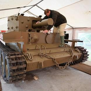 Andover Advertiser: Nicolas Dumont works on a centaur tank which has been restored after lying abandoned on the banks of the Caen Canal near Pegasus Bridge since the Normandy Landings