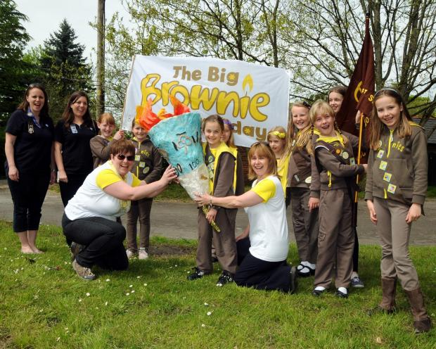 Andover Advertiser: Sherborne St John Brownies, taking part in the Big Brownie Birthday torch relay, walking in Bramley on Monday