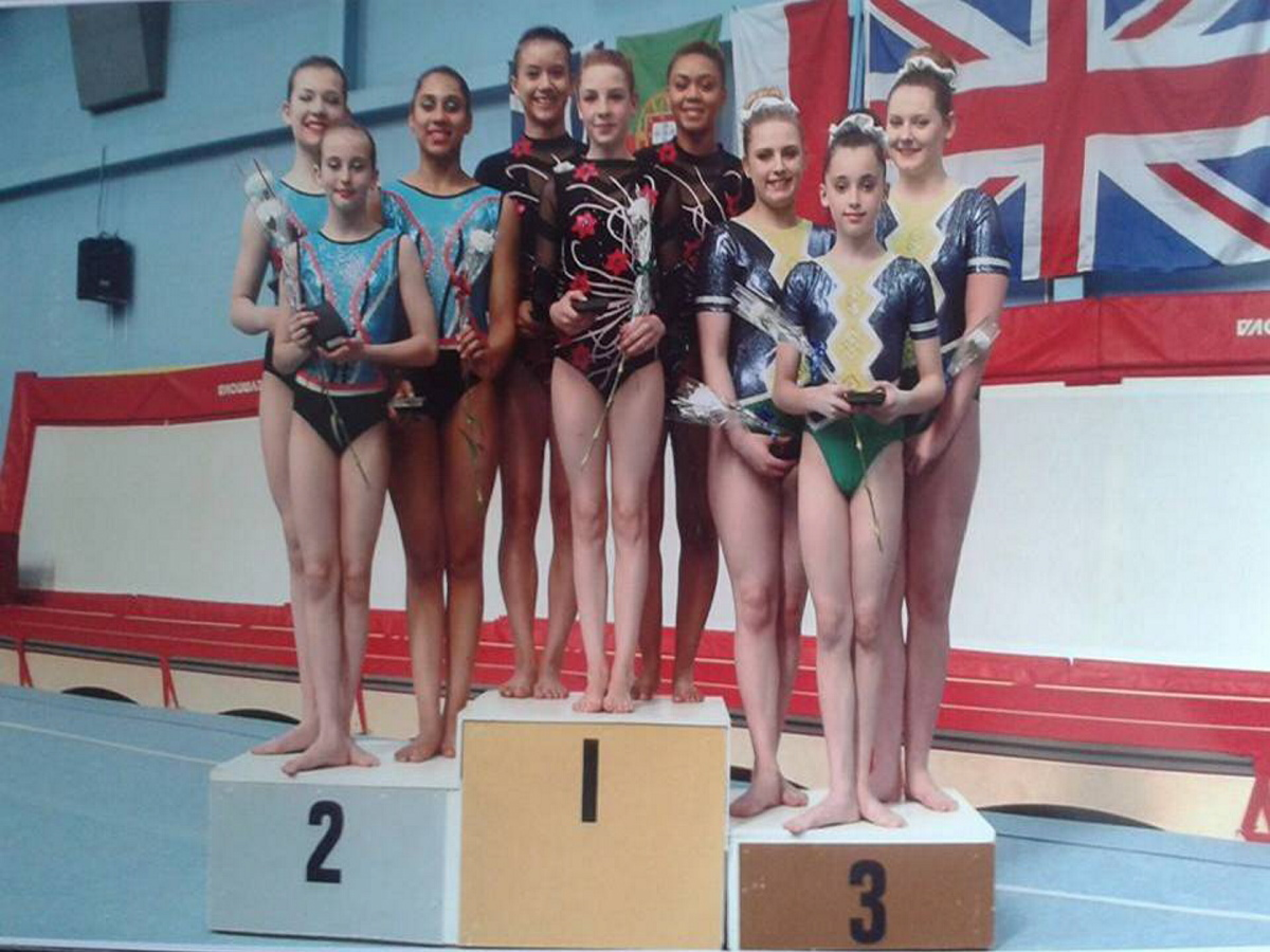 Isabelle, Leah and Tierney are pictured on the winner's rostrum