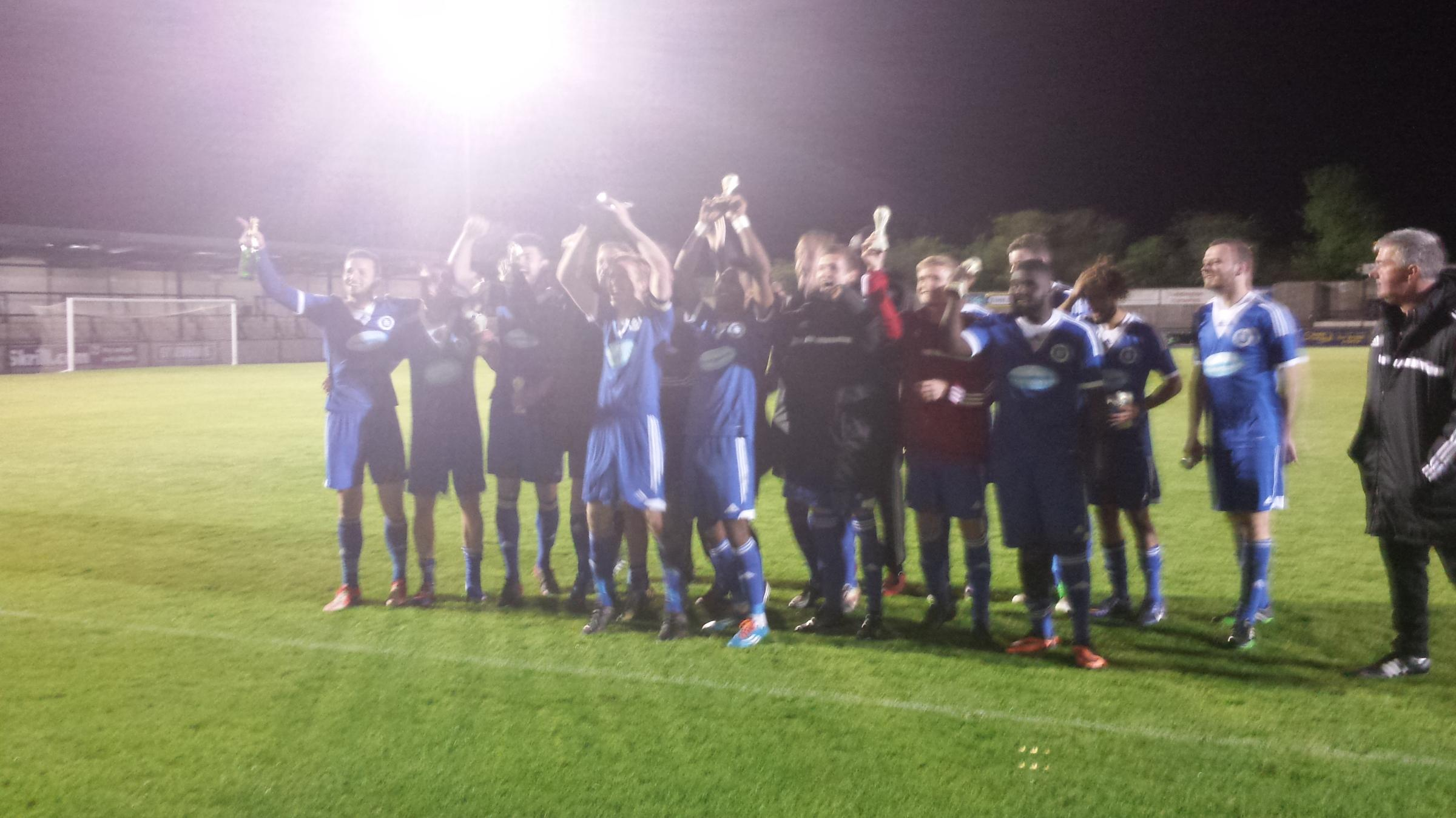 Andover Town celebrate with the Salisbury Hospital Cup, the new club's first trophy